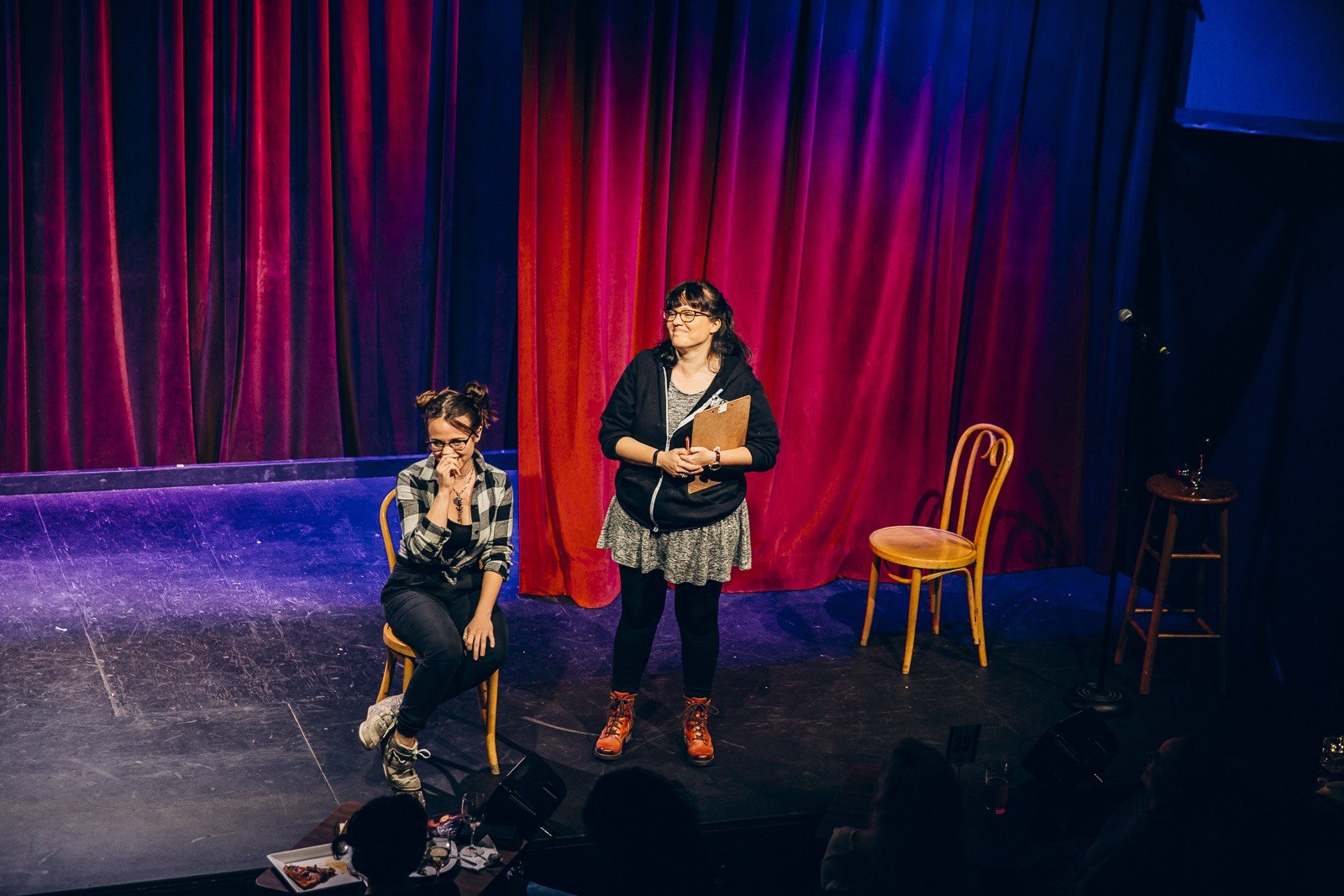 Two female comedians on stage