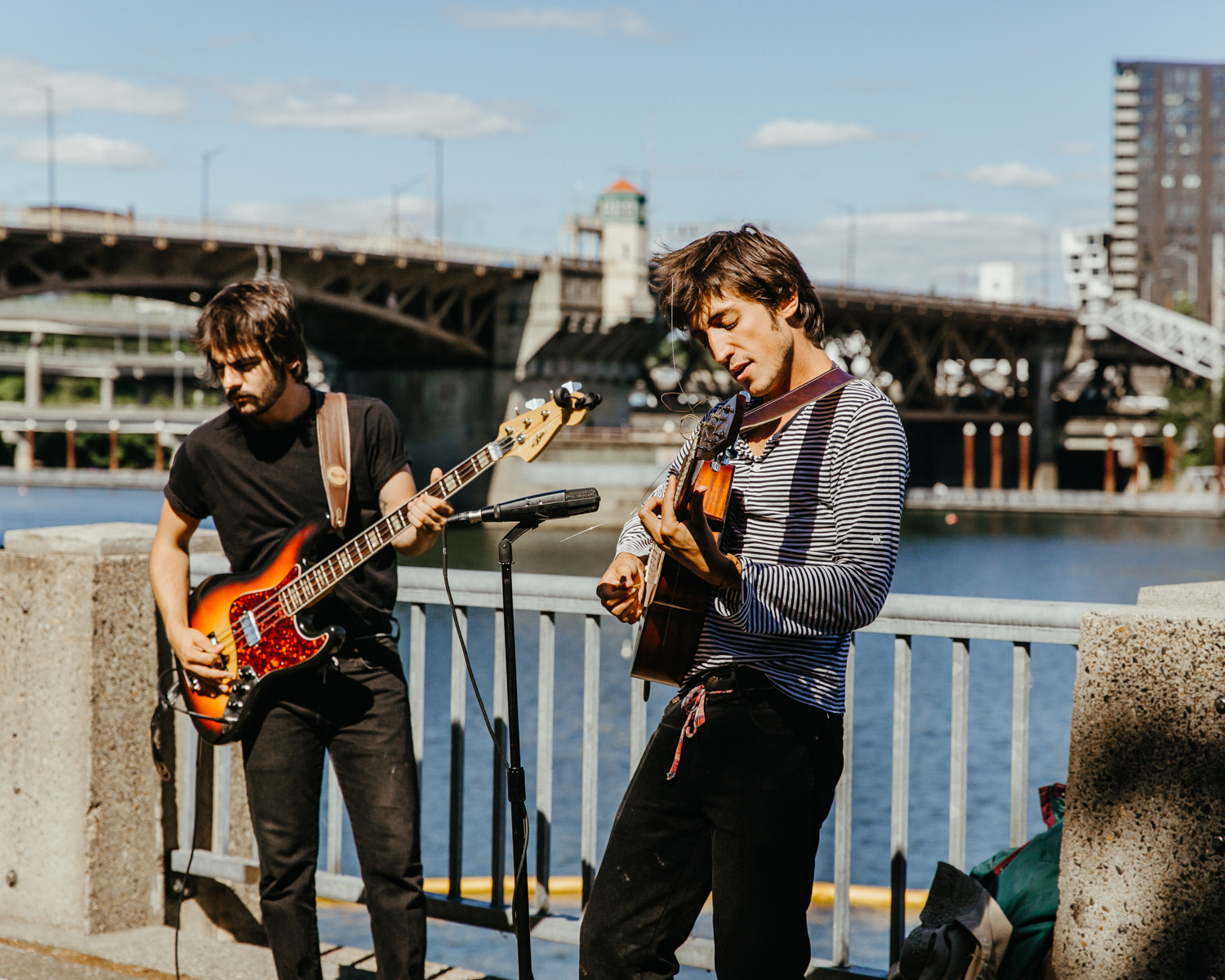 two guitarists busk along the waterfront
