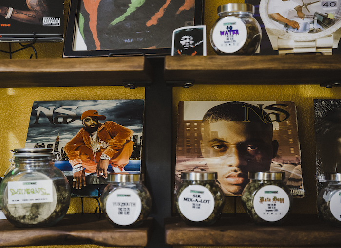 Hip-hop records and jars of rapper-themed cannabis decorate Green Hop Dispensary.