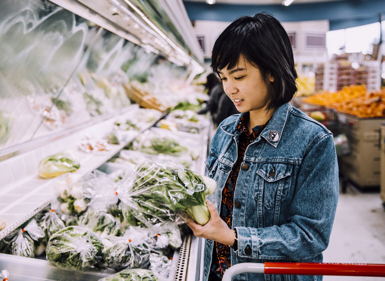 Tran shops for produce at Asian grocery store Hong Phat.