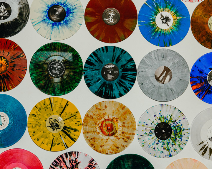 multi-colored records hanging on a wall