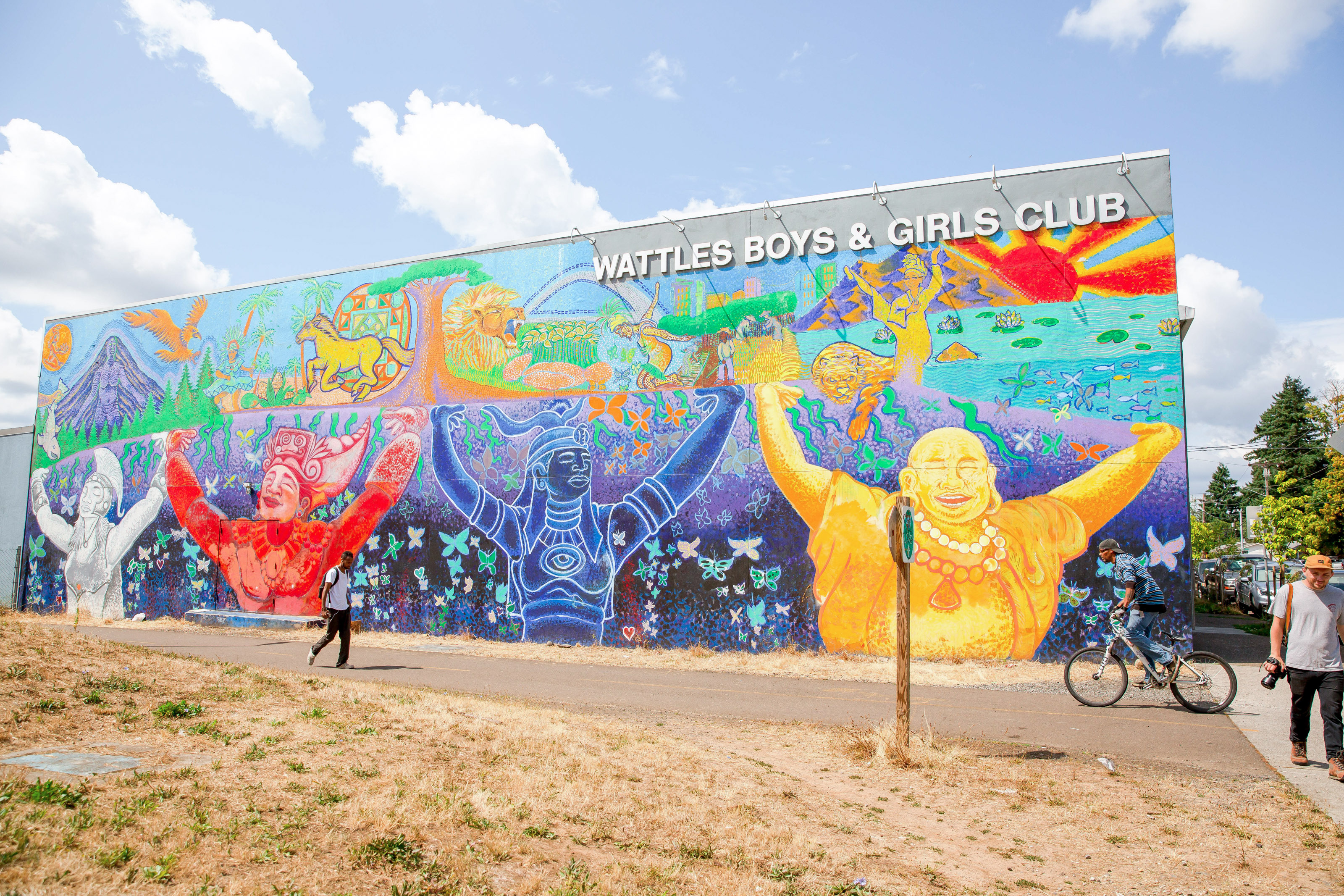 colorful mural in Lents neighborhood depicting multicultural population