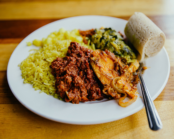 A plate full of food served by Horn of Africa restaurant.