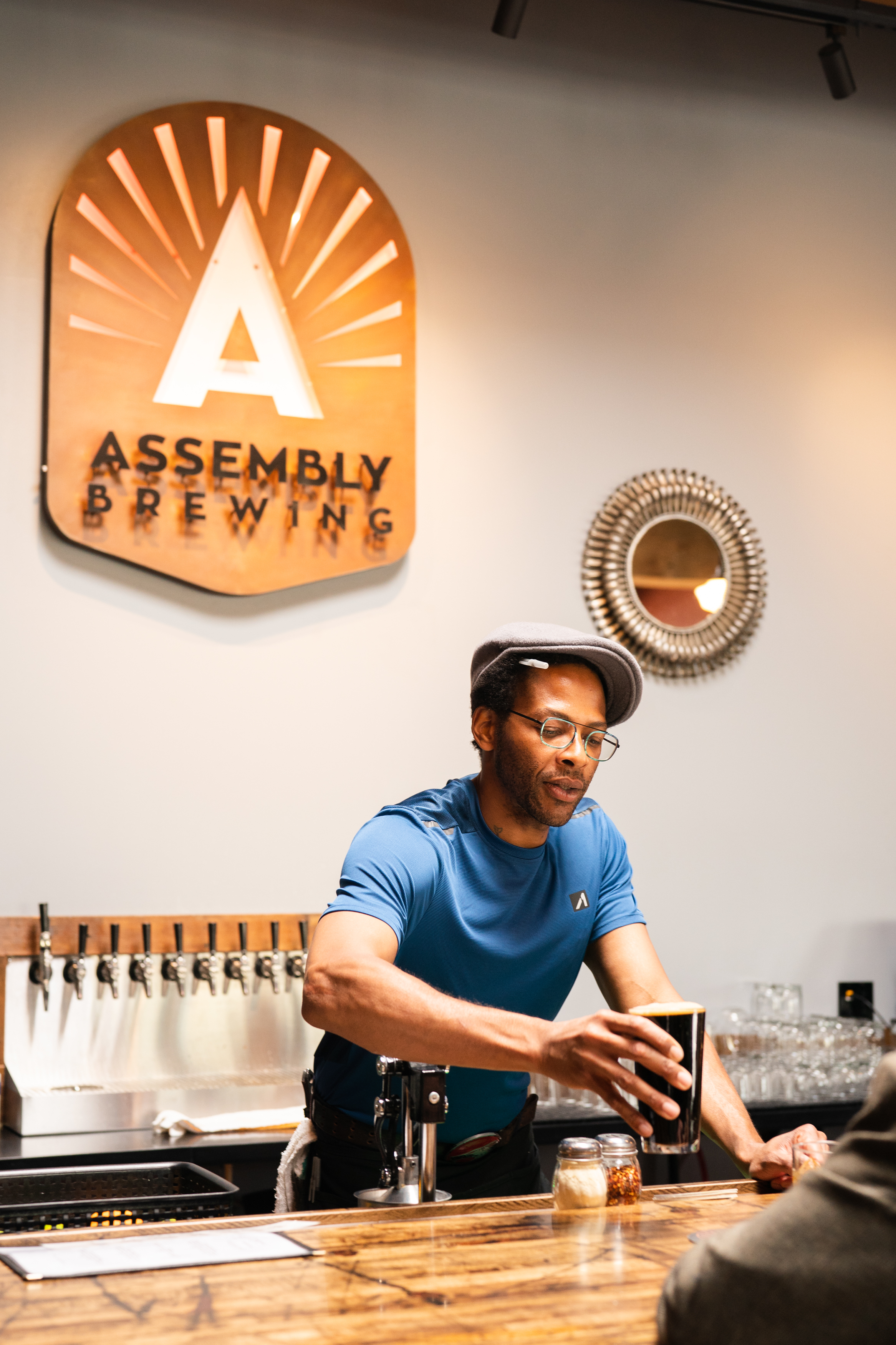 A man serves a glass of beer
