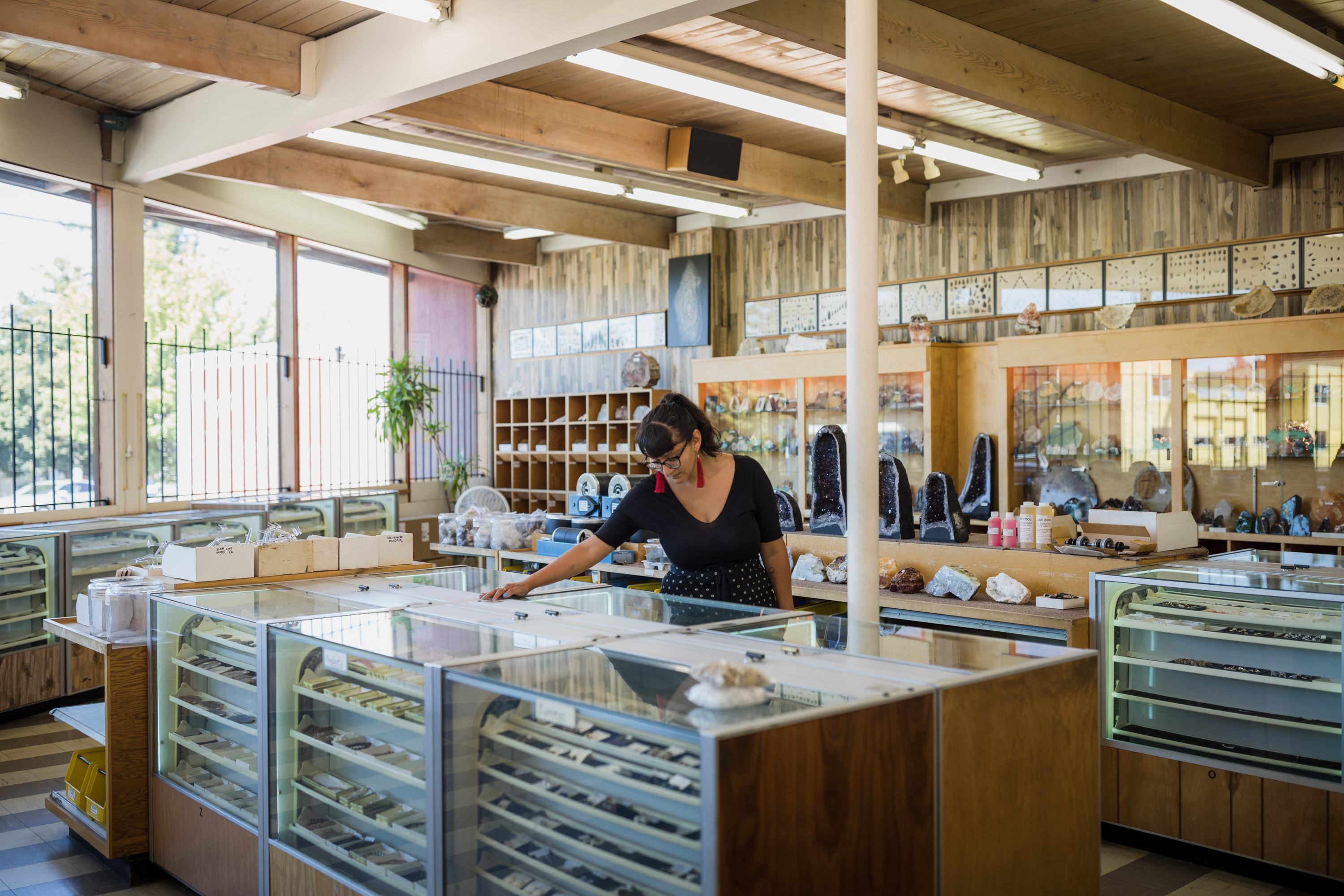 A woman peruses cabinets filled with rocks and gems