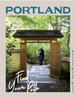 cover of Travel Portland's visitor guide, 2019-'20, featuring a woman walking through Portland Japanese Garden